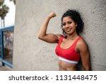 a muscular female athlete... | Shutterstock . vector #1131448475