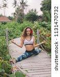 young woman practicing splits... | Shutterstock . vector #1131470732