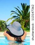 Woman enjoying summer in swimming pool - stock photo