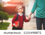 parent take child to school.... | Shutterstock . vector #1131498872