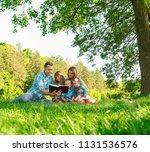 young family reading the bible... | Shutterstock . vector #1131536576