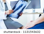 woman doctor looking at x ray... | Shutterstock . vector #1131543632