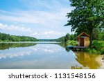 lake in sunny day. beach with...   Shutterstock . vector #1131548156