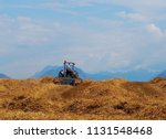 tractor with a rake hay machine ... | Shutterstock . vector #1131548468