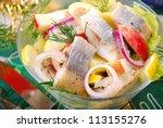 herring salad with apple and potato ,lemon and onion for christmas - stock photo