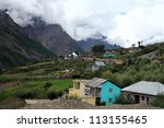 a village at the down hill of... | Shutterstock . vector #113155465