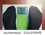 closeup male feet on scale at... | Shutterstock . vector #1131555095