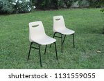 chairs on the grass in a park | Shutterstock . vector #1131559055