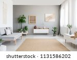 burlap artwork on grey wall... | Shutterstock . vector #1131586202