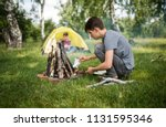 yellow tent camping. glade... | Shutterstock . vector #1131595346