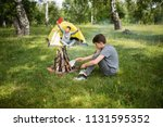 yellow tent camping. glade... | Shutterstock . vector #1131595352