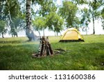 yellow tent on the nature.... | Shutterstock . vector #1131600386