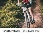 mountain biker cycling on... | Shutterstock . vector #1131601442