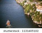 boat on the river in european... | Shutterstock . vector #1131605102