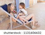 fashionable mother and child...   Shutterstock . vector #1131606632