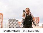 man dressed in a bulletproof... | Shutterstock . vector #1131637202