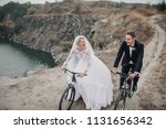 a fashionable bridegroom in a... | Shutterstock . vector #1131656342