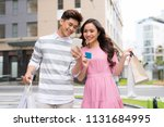 shoppers buying on line with... | Shutterstock . vector #1131684995