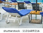 sun beds near a swimming pool | Shutterstock . vector #1131689216