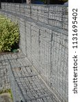 modern gabion fence wall with... | Shutterstock . vector #1131695402