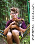 teenager boy hug puppy shepherd ... | Shutterstock . vector #1131696698