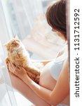 pregnant woman in white... | Shutterstock . vector #1131712592