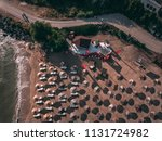 aerial view of a sunny beach... | Shutterstock . vector #1131724982