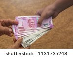 hand giving indian 500 and 2000 ... | Shutterstock . vector #1131735248