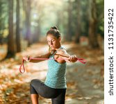 woman exercising with elastic... | Shutterstock . vector #1131735422