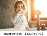the baby brushes his teeth in... | Shutterstock . vector #1131767408