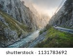 view of a stony river through... | Shutterstock . vector #1131783692