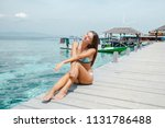 young pretty girl sitting on... | Shutterstock . vector #1131786488