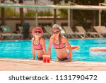 happy girls at the pool having... | Shutterstock . vector #1131790472