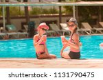 happy girls at the pool having...   Shutterstock . vector #1131790475
