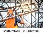 young asian maintenance worker... | Shutterstock . vector #1131804908