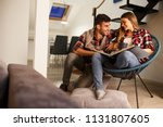 young couple looking at family... | Shutterstock . vector #1131807605