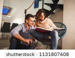 young couple looking at family... | Shutterstock . vector #1131807608