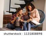 two best female friends looking ... | Shutterstock . vector #1131808898