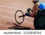 men wheelchair racer on track... | Shutterstock . vector #1131818762