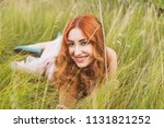 flowers and romantic woman in... | Shutterstock . vector #1131821252