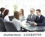 business team holds a workshop... | Shutterstock . vector #1131829745