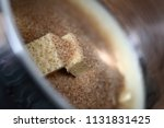 pouring brown sugar into... | Shutterstock . vector #1131831425