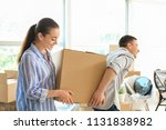 young couple carrying box... | Shutterstock . vector #1131838982