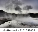 a geyser ejects hot water and... | Shutterstock . vector #1131852635