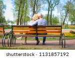 mature couple resting in park... | Shutterstock . vector #1131857192