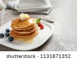 stack of tasty pancakes with... | Shutterstock . vector #1131871352