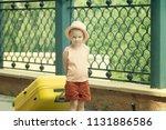 a little girl is carrying a... | Shutterstock . vector #1131886586