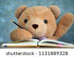 teddy bear sitting on a desk... | Shutterstock . vector #1131889328