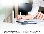 stacks of coins business... | Shutterstock . vector #1131903245