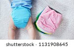 the child lies near a stack of... | Shutterstock . vector #1131908645